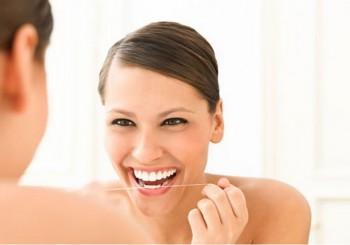 Как да използваме правилно конеца за зъби