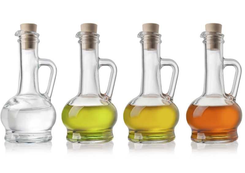 Glass Bottles Of Oil And Vinegar On White Background